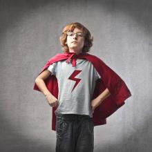 Child in superhero suit, olly / Shutterstock.com