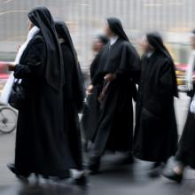Group of a nuns walking, SVLuma/Shutterstock.com