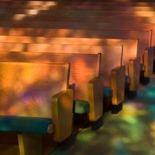 Empty church pews. Photo by Tony Marinella Photography/ Shutterstock.com.