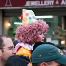 Purim carnival in Jerusalem. Unidentified people watch the show. (Ekaterina Lin