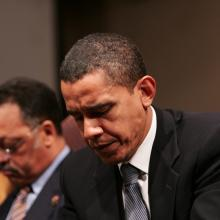 Obama in prayer. Image courtesy Stephen C./shutterstock.com
