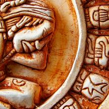 Close-up of the glyphs on the Mayan calendar.