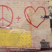 Banksy stencil grafitti in San Francisco. Radoslaw Lecyk / Shutterstock.com