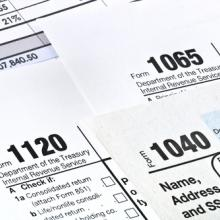 Photo: Tax forms,  © Garry L. / Shutterstock.com
