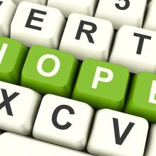 """Hope"" spelled out on a keyboard. Image via Stuart Miles/shutterstock.com"