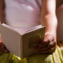 Photo: Young girl reading, AISPIX by Image Source / Shutterstock.com