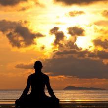 Meditating silhouette, aragami12345s/Shutterstock.com