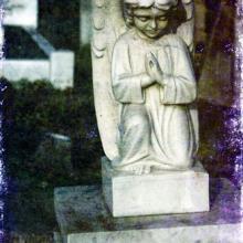 Stone cherub in London cemetery, nagib / Shutterstock.com