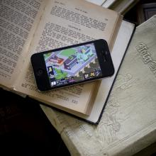 Are cell phones used in worship as tools of listening or of distraction? Photo b