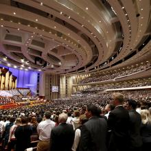 The Mormon Tabernacle Choir and conference goers sing in Salt Lake City, April 4