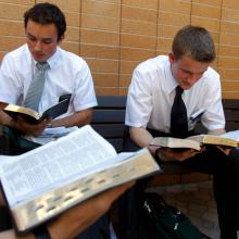 Two students study mormon scriptures at the Missionary Training Center. Photo co