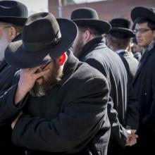 Mourners attend the funeral for seven children killed in a Brooklyn fire in New