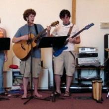 Tim King with his youth group's worship band. Photo courtesy Tim King