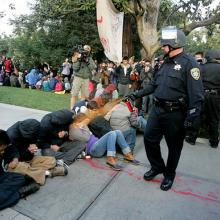 UC Davis student photojournalist Brian Nguyen's iconic photograph via The Califo