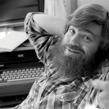 A young Jim Wallis in flannel smiling at the camera.