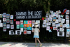 """A child looks at the """"Naming the Lost Memorials""""at The Green-Wood Cemetery in Brooklyn, N.Y., on June 10, 2021. REUTERS/Brendan McDermid."""