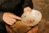 Mako Fujimura holds a bowl with golden kintsugi cracks.