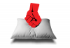 A balled fist is punching downward onto a pillow.